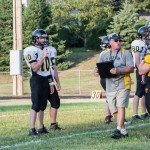 Modeltowner's coach giving his boys the run down on the field at Gwinn High School