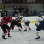 The Marquette Redmen face off against the Negaunee Miners.