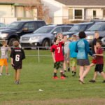 Kids were out on the practice field playing some football.