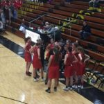 The Redettes go over their plan for the game