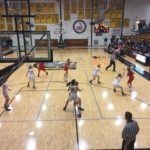 The Redettes try to find a lane against the Trojans' defense
