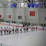 The Redmen line up for the National Anthem.