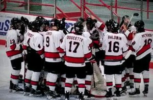 The Marquette Redmen gather around their net before the puck drop.