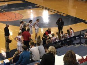 Coach Ben Smith draws up a play for his team.