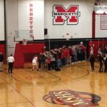 Redette Bridget Pliska goes off the court through a tunnel of fans