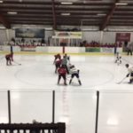 The Marquette Redmen facing off against the Kingsford Flivvers