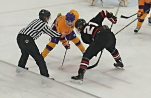 Redmen try to win the face off.