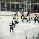 The Marquette Redmen scramble around the Saline net