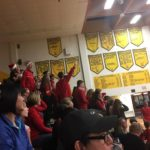 The Marquette Student section cheers their team on against Negaunee