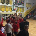 The Marquette Redmen lift the Victors' Cup