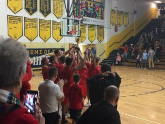 The Marquette Redmen lift the Victors' Cup