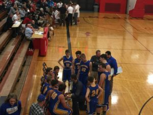 Kingsford draws up a play. Their offense clicked against Marquette.