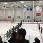 The Traverse City West Titans lined up for the national anthem
