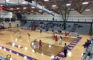 The Marquette Redettes and Gladstone Braves on the Court from Gladstone High School in Gladstone, Michigan