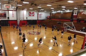 The Marquette Redettes and the Calumet Copper Kings warming up before the game