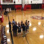 The Blue Devils gather around their coach