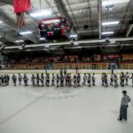 The two teams shake hands after a hard-fought game