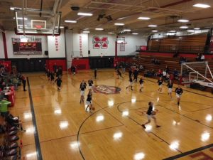 The Marquette Redettes warming up for their game against the Gwinn Modeltowners