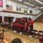 The Marquette Redmen huddle around their bench and go over their strategies