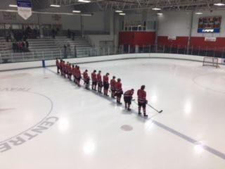 The Marquette Redmen lined up for the national anthem