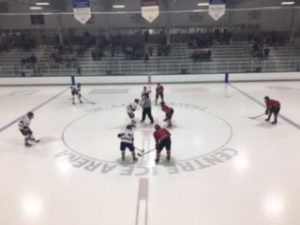 The Marquette Redmen and the Bay Reps are lined up for a faceoff at center ice