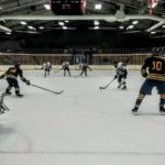 The Marquette Redmen attacking the Negaunee Miners' net