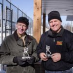 Randy Girard and Todd Noordyk with some of the award trophies for the winning team.