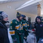 Ryan and Luke talking to the President and Captain of the NMU Hockey Club Team.