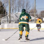 Playing on the ice at Lions Field in Marquette Township.