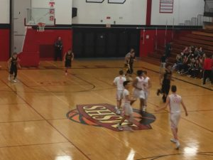 The Marquette Redmen Basketball Team defeats the Gwinn ModelTowners 65-35 on their home turf.