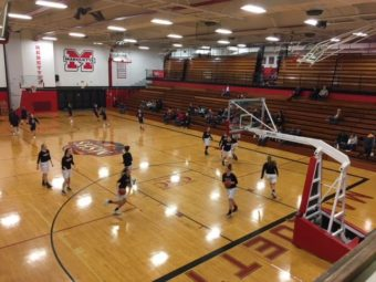 The Marquette Redettes and the Westwood Patriots warming up before the game