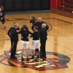 The team captains meet at mid-court