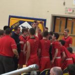The Marquette Redmen at the bench before the game