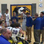 The Flivvers listen to their coach during a time-out