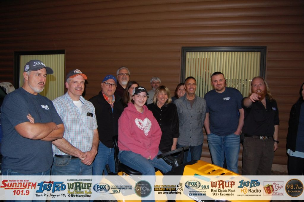 Tasha Vangundy with Todd Noordyk, Chuck Bergdahl, and the Great Lakes Radio Staff and other Sponsors