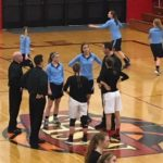 The team captains talking with the officials