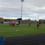 Marquette football warms up before taking on the Kingsford Flivvers.