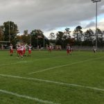 The Redmen warm up for a Kingsford Flivvers match-up.