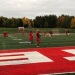The Marquette Redmen prepare to take on the Gladstone Braves.