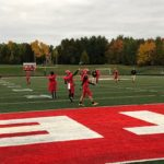 The Redmen warm up on a chilly night against the Gladstone Braves at home.