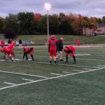 The Redmen warm up to face off against the Gladstone Braves.