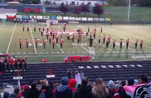 The Marquette Redmen Band keeps senior night festive on a chilly October evening.