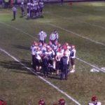 The Redmen huddle up.