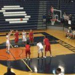 The Marquette Redmen watch as a Bulldog shoots a free throw.