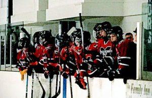 The Redmen cheer on their teammates.