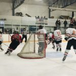 Some action behind the Eskymo goal for the Redmen.