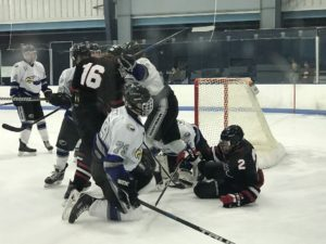 Ryan Baldwin, 16, in the scrum at the net.