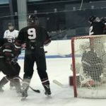 Evan Kroll helps protect the Redmen goal.