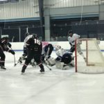 Ryan Baldwin enters the fray close to the Eagles' net.