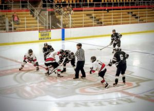 The Redmen and Panthers face off during the opening puck drop for their game on 97.5 GTO-FM